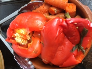 Poached red bell peppers and soft cooked carrots get pureed with herbs and cooled broth for a hearty, satisfying base.